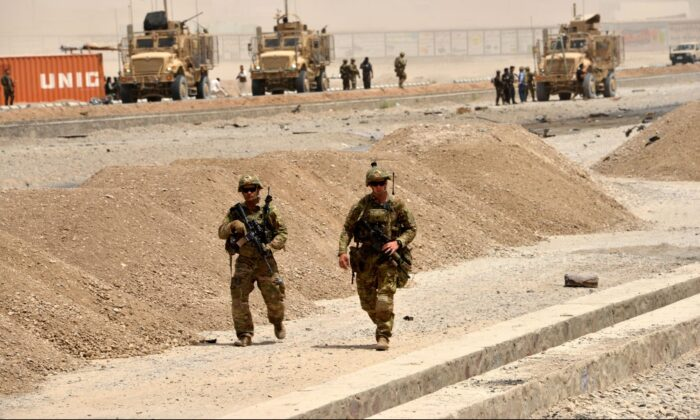 U.S. soldiers walk at the site of a Taliban suicide attack in Kandahar in a file photo. (Javed Tanveer/AFP/Getty Images)