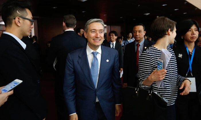 Canada's International Trade Minister Francois-Philippe Champagne (C) leaves a press conference during the Asia-Pacific Economic Cooperation (APEC) 23rd Ministers responsible for Trade Meeting in Hanoi, Vietnam, on May 21, 2017. (Kham/AFP via Getty Images)