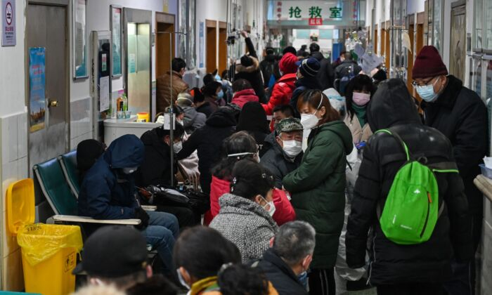 People are waiting for medical attention at Wuhan Red Cross Hospital in Wuhan, China on Jan. 25, 2020. (Hector Retamal/AFP via Getty Images)