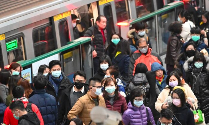 Mask-clad commuters get off a train at a Mass Rapid Transit (MRT) stop in Taipei following the Lunar New Year holidays on Jan. 30, 2020. (Sam Yeh/AFP via Getty Images)