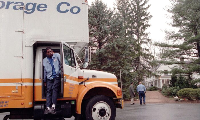 A United Van Lines employee gets out of a moving van in Chappaqua, New York, on Jan. 4, 2000. (DOUG KANTER/AFP via Getty Images)