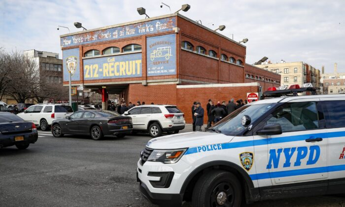 New York City police officers work the scene of a police involved shooting outside the 41st precinct in New York on Feb. 9, 2020. (John Minchillo/AP Photo)