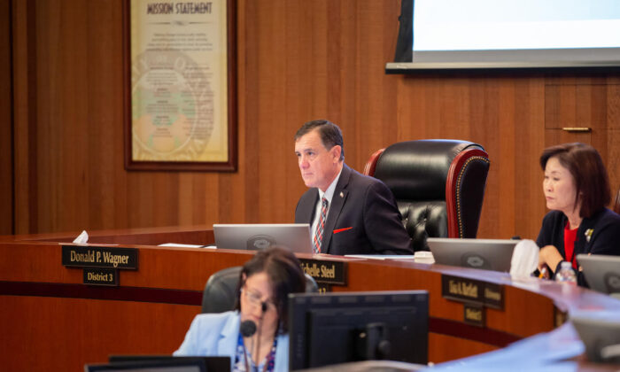 Supervisor Donald P. Wagner and Chairwoman Michelle Steel, right, attend a meeting of the Orange County Board of Supervisors in Santa Ana, Calif. (Courtesy of Donald P. Wagner)