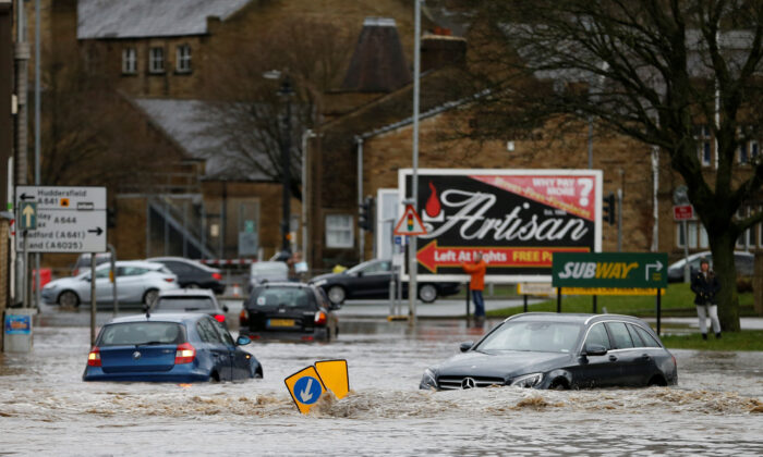 Cars sit in floodwater in Brighouse, West Yorkshire, Britain Feb, 9, 2020. (Ed Sykes/Reuters)