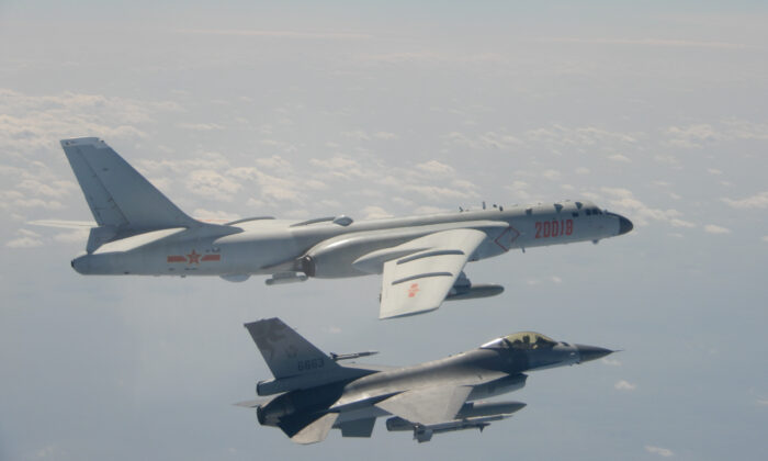 An H-6 bomber of Chinese PLA Air Force flies near a Taiwan F-16 in this Feb. 10, 2020 handout photo provided by Taiwan Ministry of National Defense. In a statement, the ministry said Chinese J-11 fighters and H-6 bombers flew into the Bashi Channel to the south of Taiwan, then out into the Pacific before heading back to base via the Miyako Strait. (Taiwan Ministry of National Defense/Handout via Reuters)