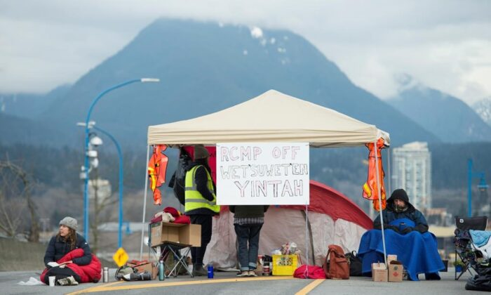Protesters block the road access to one of Vancouver's port entrances in Vancouver on Feb. 9, 2020. (The Canadian Press/Jonathan Hayward)