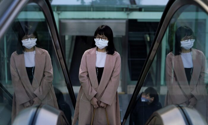 A woman wearing a mask is seen as the country is hit by an outbreak of the novel coronavirus in Shanghai, China February 10, 2020. (Aly Song/Reuters)