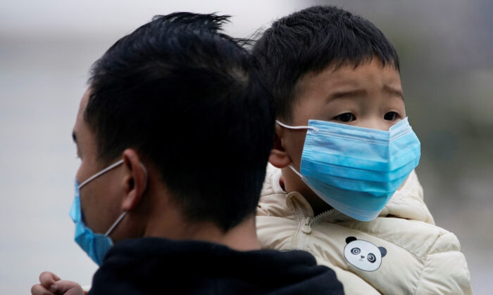 Passengers wearing masks walk outside the Shanghai railway station in Shanghai, China, as the country is hit by an outbreak of the new coronavirus, Feb. 8, 2020. (REUTERS/Aly Song)