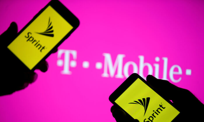Smartphones with Sprint logo are seen in front of a screen projection of T-mobile logo, on April 30, 2018. (Dado Ruvic/Reuters/Illustration)