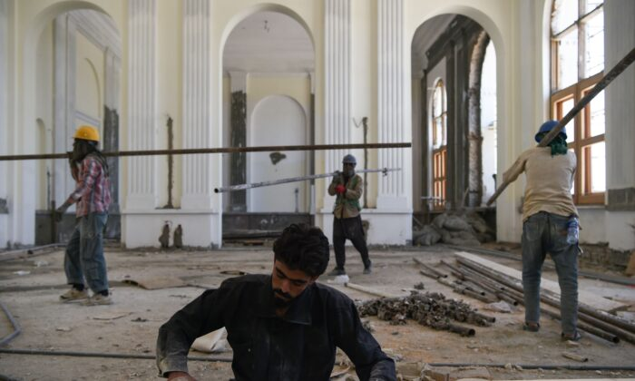 Afghan laborers work on the renovation of Darulaman Palace in Kabul on Aug. 1, 2019. (WAKIL KOHSAR/AFP via Getty Images)