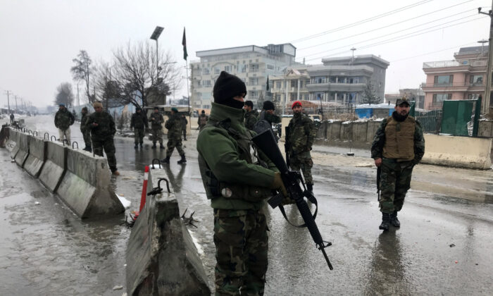 Afghan security forces keep watch at the site of a blast in Kabul, Afghanistan, on Feb. 11, 2020. (Omar Sobhani/Reuters)