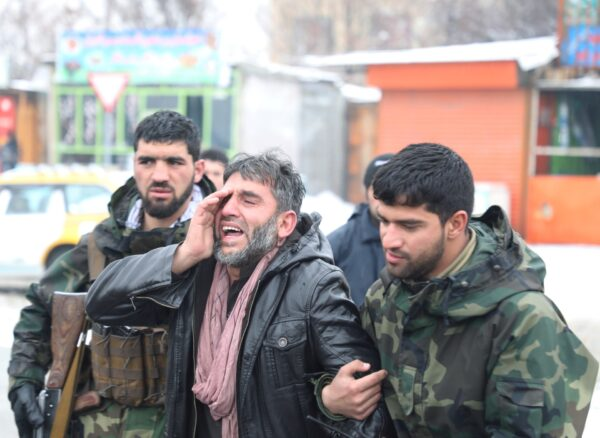 An Afghan man reacts- suicide attack in Kabul, Afghanistan