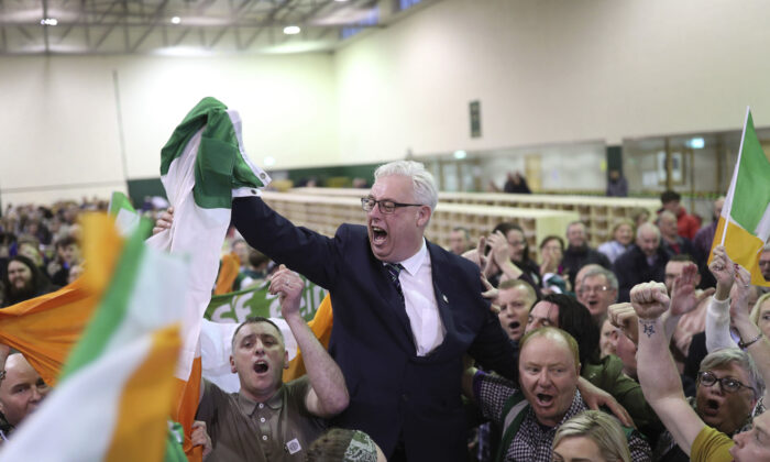 Thomas Gould of Sinn Fein tops the poll and is elected in Cork North Central, during the Irish General Election count at the Nemo Rangers GAA Club in Cork, Ireland. (Yui Mok/PA via AP)