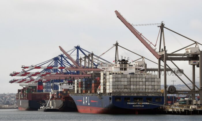 Shipping containers are unloaded at the Port of Los Angeles in Long Beach, California on May 14, 2019. (Mark Ralston/AFP via Getty Images)