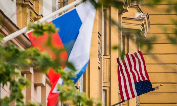 A Russian flag flies next to the U.S. embassy building in Moscow on July 31, 2017. (Mladen Antonov/AFP via Getty Images)
