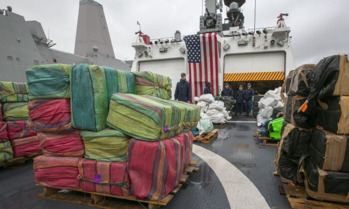 The crew of the Coast Guard Cutter Munro offloaded 20,000 pounds of uncut cocaine seized from known drug-transit zones of the Eastern Pacific Ocean worth approximately $338 million at Naval Station San Diego on Feb. 10, 2020. (John Gibbins/The San Diego Union-Tribune via AP)