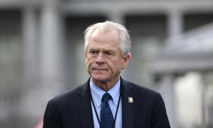 White House trade adviser Peter Navarro listens to a news conference about a presidential executive order relating to military veterans outside of the West Wing of the White House, on March 4, 2019. (Leah Millis/Reuters)