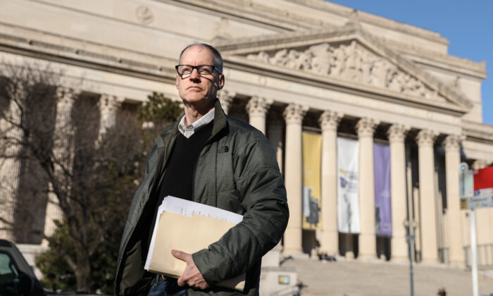 Don Lueders, a former government contractor and certified records manager, stands in front of the National Archives Building in Washington, on Feb. 8, 2020. (Samira Bouaou/Epoch Times)
