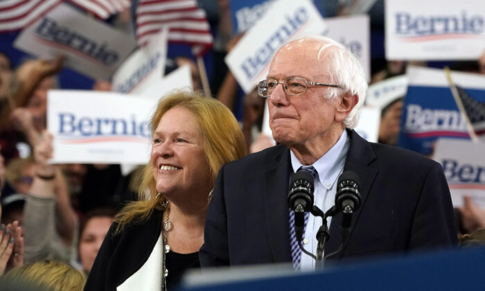 Democratic presidential hopeful Vermont Senator Bernie Sanders (I-Vt.) arrives, flanked by his wife Jane O'Meara Sanders, to speak at a Primary Night event at the SNHU Field House in Manchester, New Hampshire, on Feb. 11, 2020.  Timothy A. Clary/AFP via Getty Images