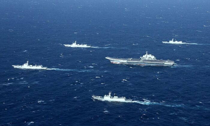 A Chinese navy formation, including the aircraft carrier Liaoning (C), during military drills in the South China Sea, on Jan. 2, 2017. (STR/AFP via Getty Images)