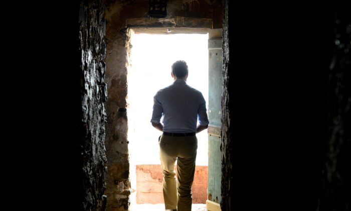 Prime Minister Justin Trudeau looks out from the Door of No Return at the slave house on Goree Island, Dakar, Senegal, on Feb. 12, 2020. (The Canadian Press/Sean Kilpatrick)