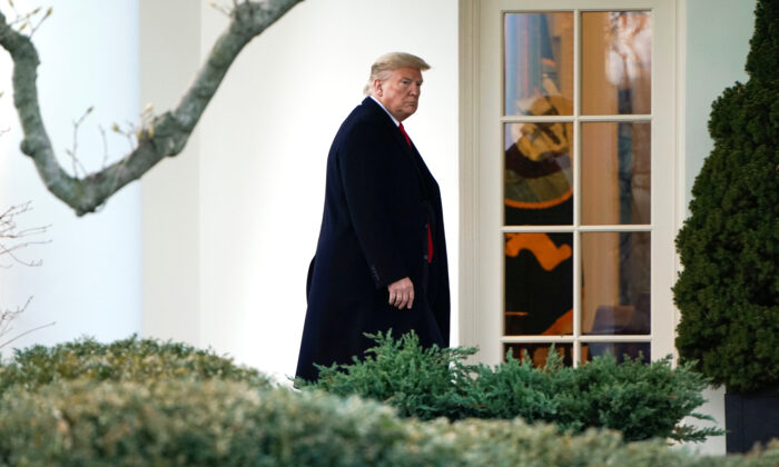 President Donald Trump walks to the Oval Office as he returns from a day trip from North Carolina at the White House in Washington, on Feb. 7, 2020. (Joshua Roberts/Reuters)