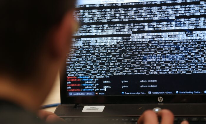 A student from an engineering school attends a hacking challenge near Paris on March 16, 2013. (Thomas Samson/AFP/Getty Images)