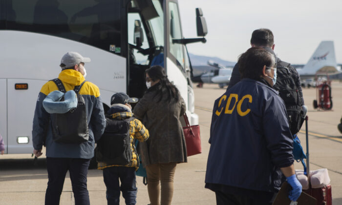 ThisFeb. 5, 2020, file photo provided by the U.S. Department of Health and Human Services shows evacuees from China arriving at Marine Corps Air Station in Miramar, Calif. (Krysten I. Houk/U.S. Department of Health and Human Services via AP, File)