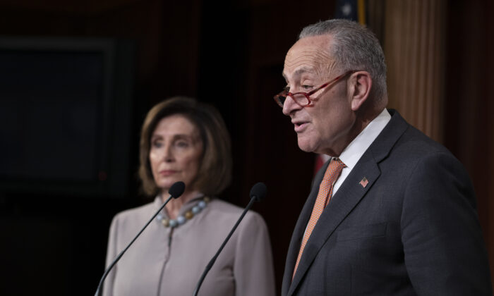 Senate Minority Leader Chuck Schumer (D-N.Y.) and House Speaker Nancy Pelosi (D-Calif.) speak in Washington on Feb. 11, 2020. (Tasos Katopodis/Getty Images)
