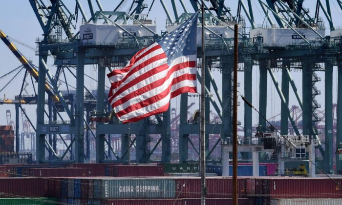 The U.S. flag flies over Chinese shipping containers that were unloaded at the Port of Long Beach, in Los Angeles County on Sept. 29, 2018. (Mark Ralston/AFP/Getty Images)