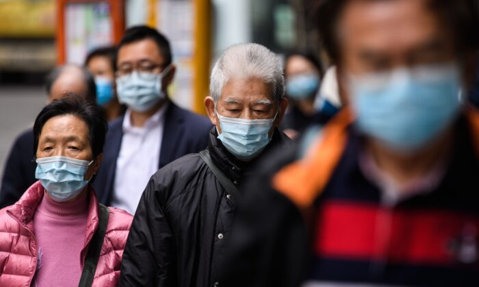 People in Hong Kong wear protective masks on Feb. 3, 2020. (Anthony Wallace/AFP via Getty Images)