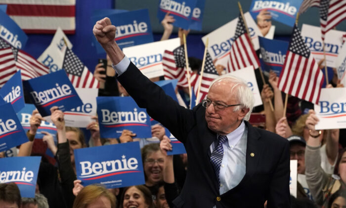 Democratic presidential hopeful Sen. Bernie Sanders (I-Vt.) arrives to speak at a Primary Night event at the SNHU Field House in Manchester, New Hampshire, on Feb. 11, 2020.  Timothy A. Clary/AFP via Getty Images