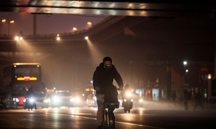 A Chinese man wears a protective mask in Beijing on Feb. 13, 2020. (Kevin Frayer/Getty Images)
