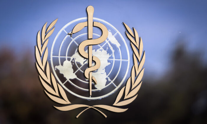 The logo of the World Health Organization (WHO) is pictured on the facade of the WHO headquarters in Geneva, Switzerland, on Oct. 24, 2017. (Fabrice Coffrini/ Getty Images)