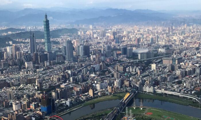 Nan Shan Plaza (L) and Taiwan's landmark building Taipei 101 are pictured through the window of an airplane, in Taipei, Taiwan on Aug. 19, 2018. (Tyrone Siu/Reuters)