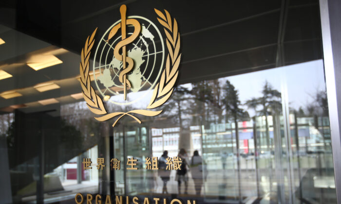 A logo is pictured outside a building of the  World Health Organization (WHO) during an executive board meeting on update on the coronavirus outbreak, in Geneva, Switzerland, on Feb. 6, 2020. (Denis Balibouse/Reuters)