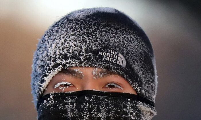 A runner wears the cold on his face while running along West River Parkway hills on Feb. 13, 2020, near downtown Minneapolis, with temperatures hovering near minus 30 degrees Fahrenheit with wind chills. (David Joles/Star Tribune via AP)