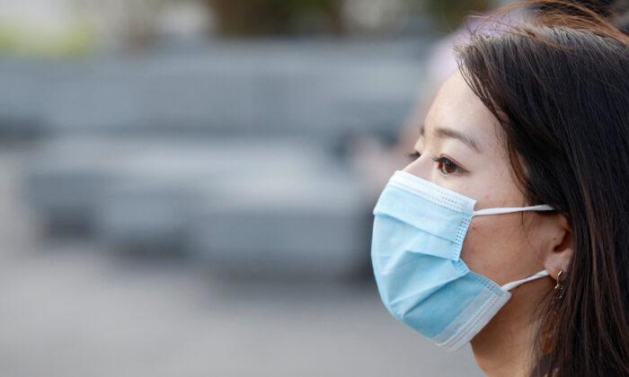 A woman wearing a face mask is seen in Ho Chi Minh, Vietnam, on Feb. 13, 2020. (Yen Duong/Reuters)