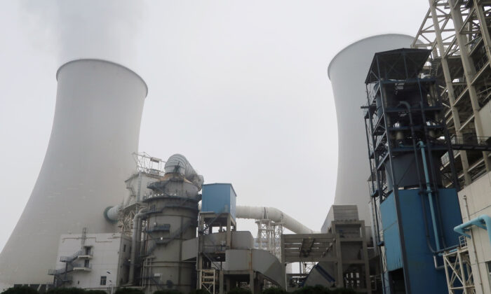 Smoke is seen from a cooling tower of a China Energy ultra-low emission coal-fired power plant during a media tour, in Sanhe, Hebei Province, China on July 18, 2019. (Shivani Singh/Reuters)