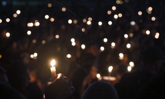 Attendees hold up their candles at a candlelight vigil for the victims of the shooting at Marjory Stoneman Douglas High School, in Parkland, Fla., on Feb. 15, 2018. (Wilfredo Lee/AP Photo/File)