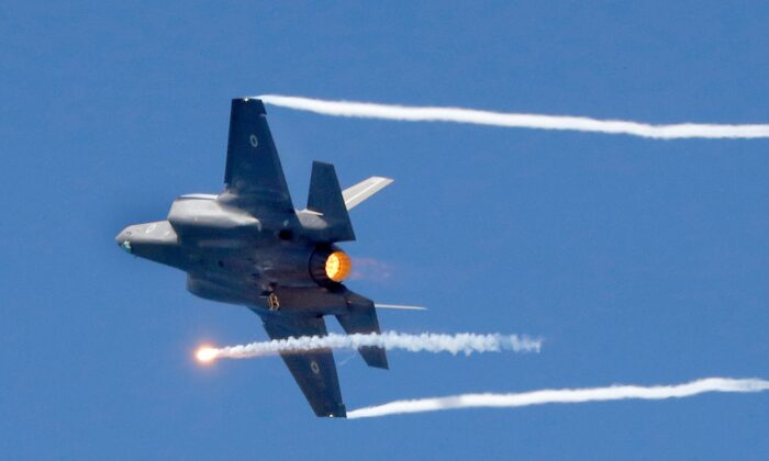 An Israeli F-35 fighter jets performs during an air show, over the beach in the Mediterranean coastal city of Tel Aviv, on May 9, 2019. (Jack Guez/via Getty Images)