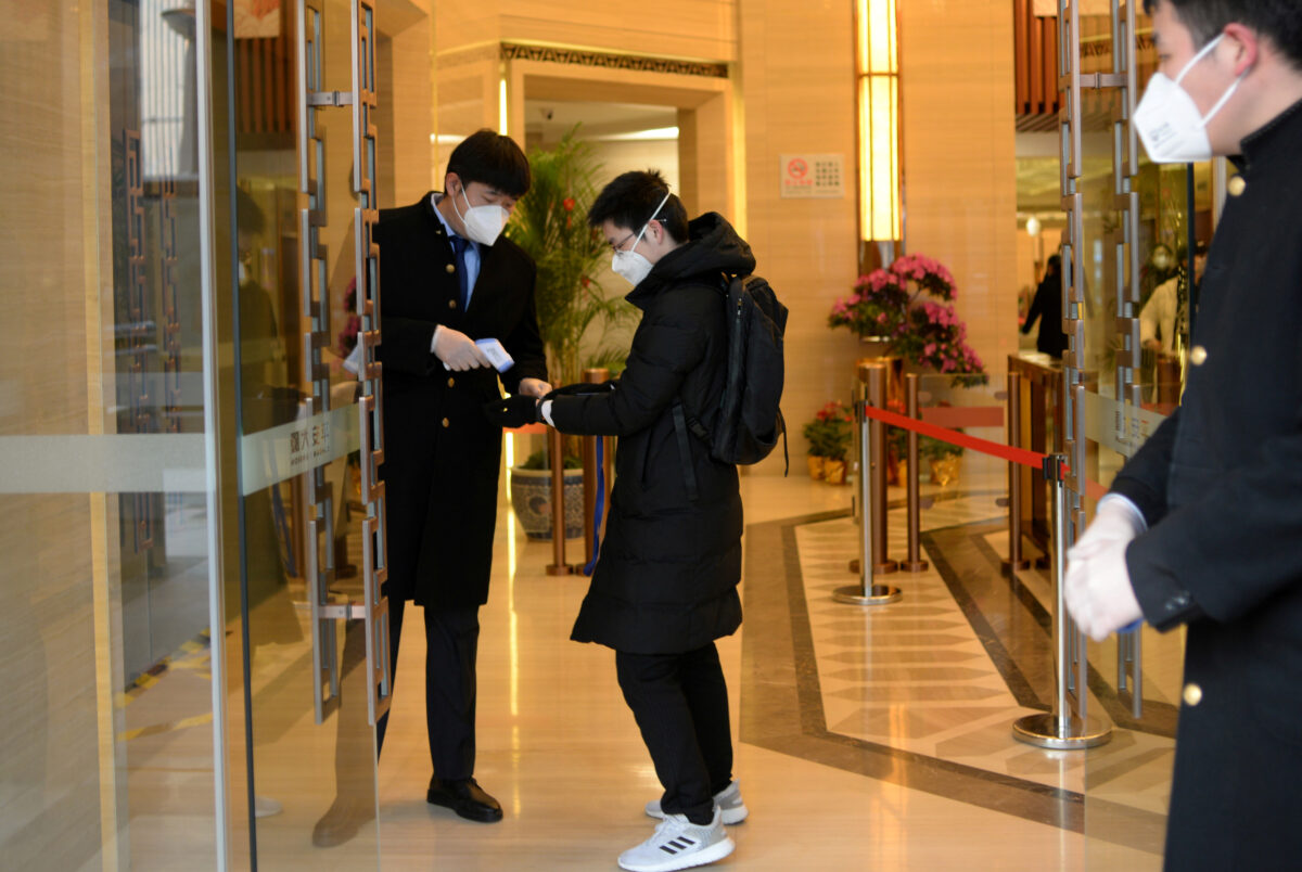 Solo Lunches and Masks: Chinese Returning to Work Grapple With Coronavirus