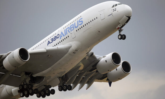An Airbus A380 takes off for its demonstration flight at the Paris Air Show in Le Bourget airport, Paris, on June 18, 2015. (AP Photo/Francois Mori)