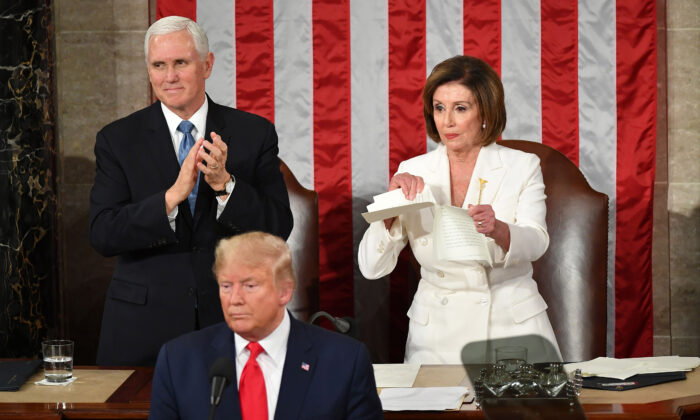 Vice President Mike Pence claps as Speaker of the House of Representatives Nancy Pelosi rips a copy of President Donald Trump's speech after he delivers the State of the Union address at the Capitol in Washington on Feb. 4, 2020. (Mandel Ngan/AFP via Getty Images)
