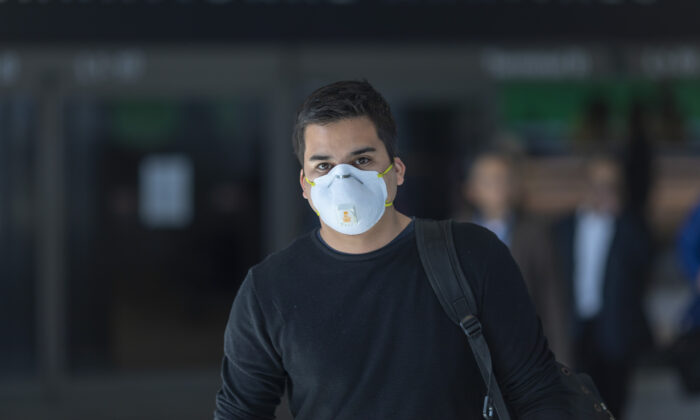 A man wearing a mask at Los Angeles International Airport in California on Feb. 2, 2020. (David McNew/Getty Images)