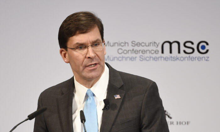 U.S. Secretary of Defence Mark Esper speaks on the second day of the Munich Security Conference in Munich, Germany, on Feb. 15, 2020. (AP Photo/Jens Meyer)
