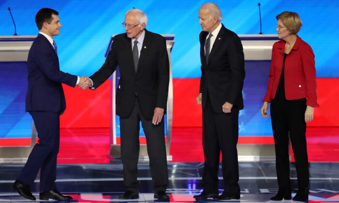 Democratic presidential candidates former South Bend, Indiana, Mayor Pete Buttigieg and Sen. Bernie Sanders (I-VT) shake hands as former Vice President Joe Biden and Sen. Elizabeth Warren (D-MA) look on prior to the start of the Democratic presidential primary debate in the Sullivan Arena at St. Anselm College on Feb. 07, 2020 in Manchester, New Hampshire. (Joe Raedle/Getty Images)
