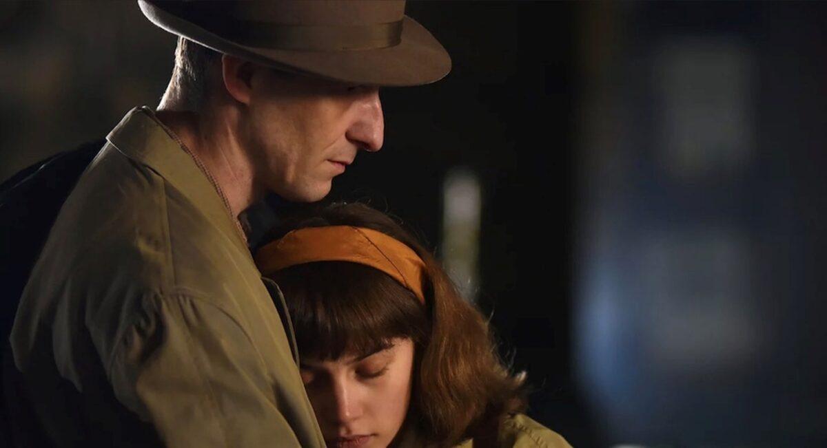 man and daughter hugging