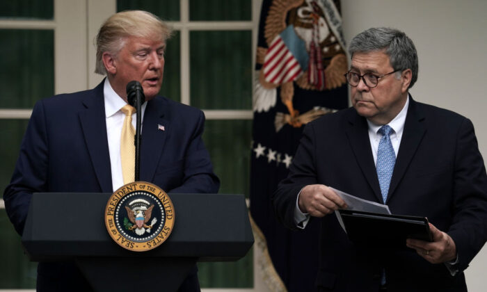President Donald Trump with Attorney General William Barr (R) in the Rose Garden of the White House on July 11, 2019.  Alex Wong/Getty Images