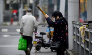 Chinese Cities Enact More Restrictive Measures to Contain Coronavirus